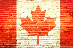 ETS Blog - Kanada Flagge auf Steinwand